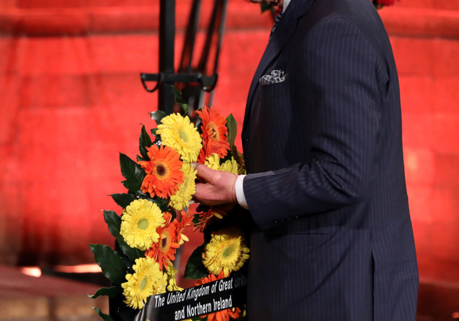 Britain's Prince Charles lays a wreath during the Fifth World Holocaust Forum at the Yad Vashem Holocaust memorial museum in Jerusalem, on January 23 (REUTERS).