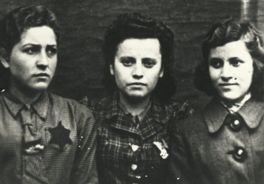 A photo of three Polish young women wearing yellow stars (Credit: United States Holocaust Memorial Museum/Gift of Mark Grinberg via JTA)
