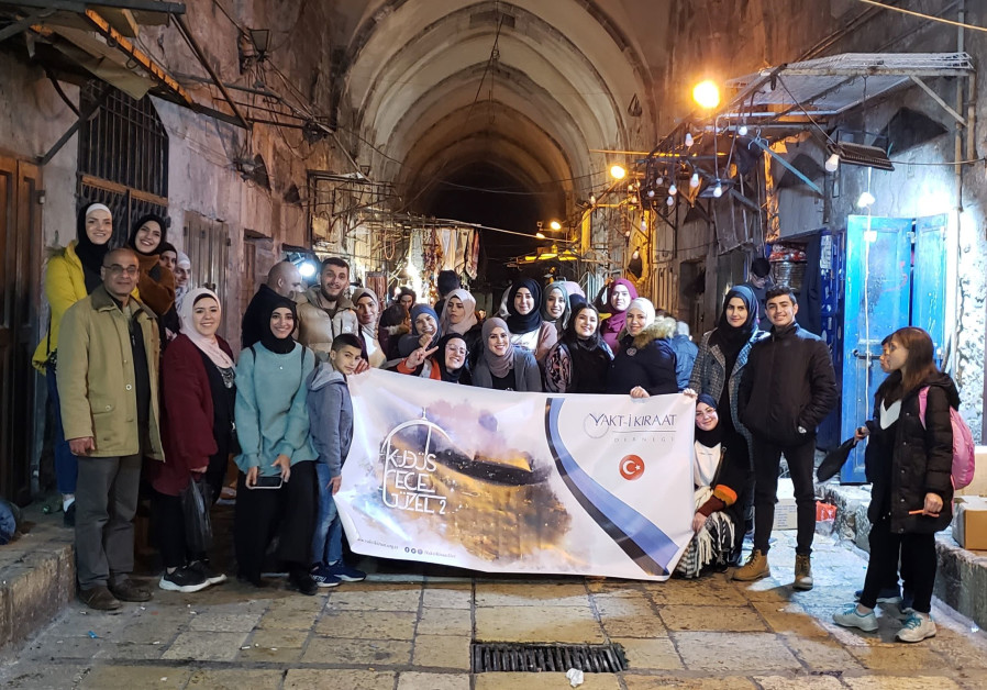 Vakt-i Kıraat group stops for a photo in the Muslim Quarter of the Old (Credit: Shakir Rimzy)