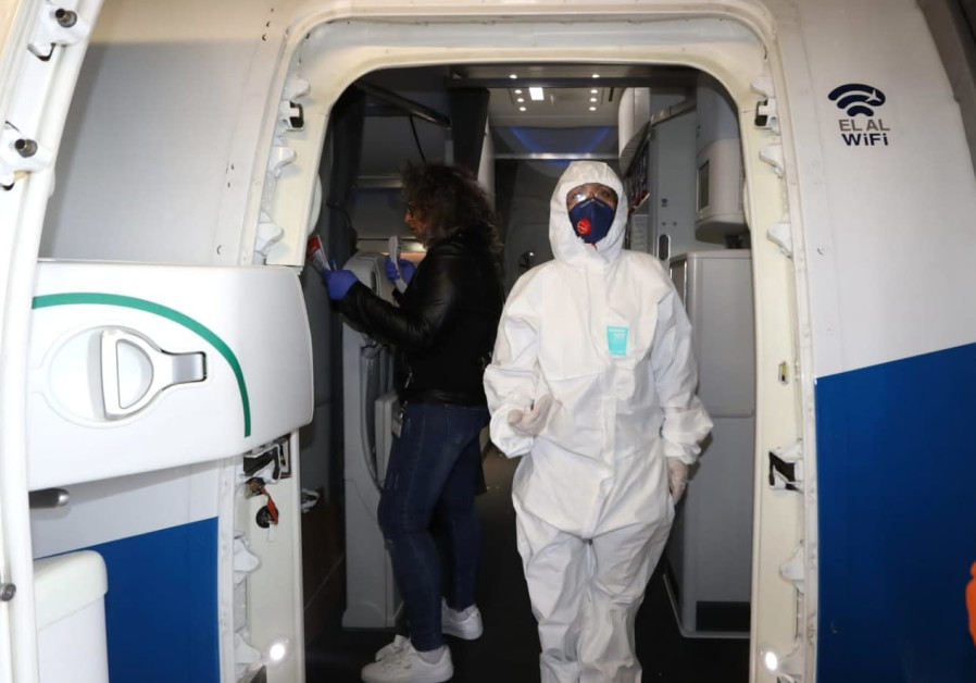 Staff disembark the El Al flight dressed in protective gear to protect them from contracting the coronavirus (credit: Sivan Farag)