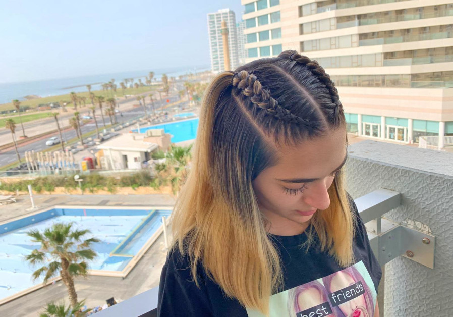 Amit Katzav demonstrates her styling skills on another 'guest' at the Dan Panorama Hotel in Tel Aviv. (Credit: Amit Katzav)