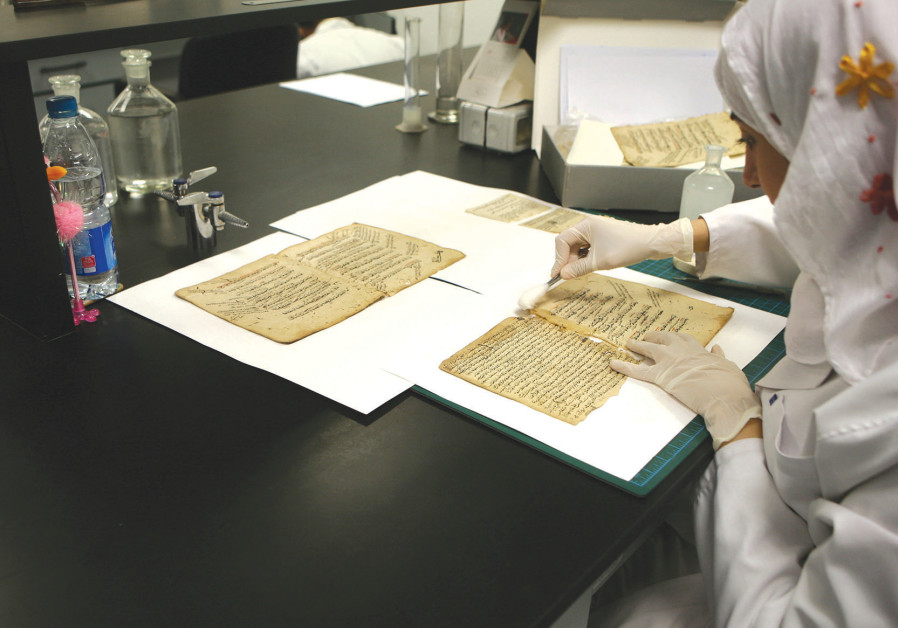 An Egyptian librarian fixes sections of rare books in the restoration laboratory of Alexandria Library in 2009 (Photo Credit: Tarek Mostafa/Egypt Society)
