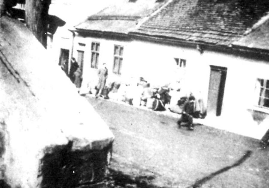 THE only photograph of a Boskovice family gathering their possessions before the deportation of all the town's Jews to the Terezin concentration camp (known as Theresienstadt in German).  (Photo Credit: Courtesy)