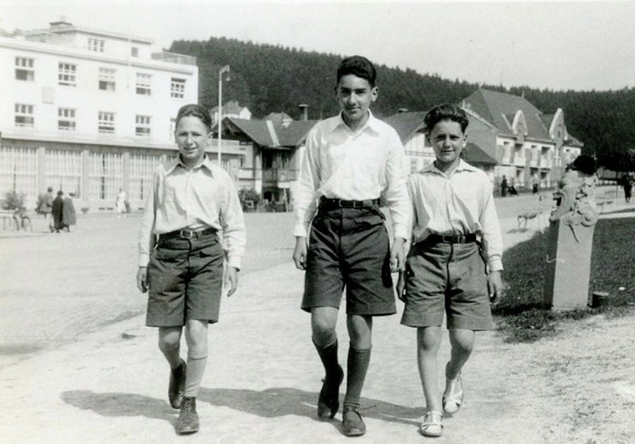 WALKING ALONG the Luhacovice street: Karl (center) at 8 and Frantisek at 6, with Vienna cousin Fritz (Aaron) Kritzler (left) (Photo Credit: Courtesy)