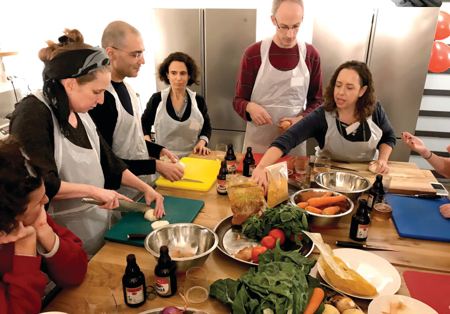 Kitchen Talks' participants dig in after preparing the Eritrean dishes (Photo Credit: Linda Gradstein)