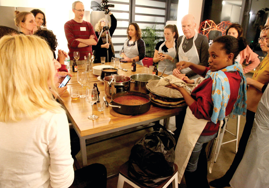 Cooking traditional Eritrean dishes (Photo Credit: Linda Gradstein)
