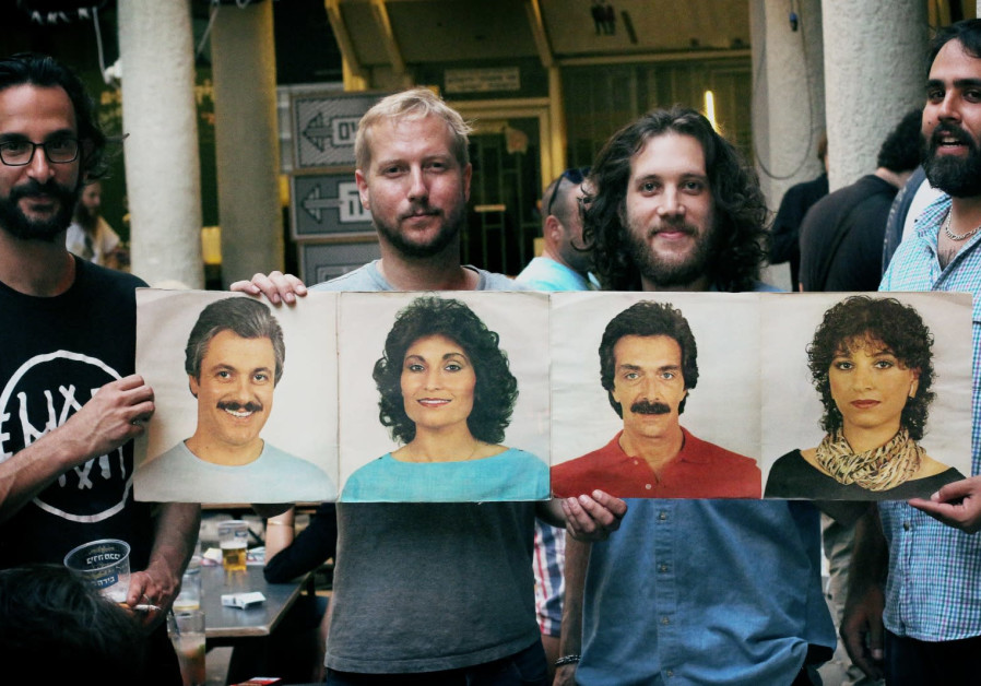 THE FORTUNA Records crew hold up an insert from a record in their collection. (Photo: Ariel Efron)