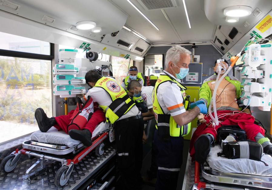 Magen David Adom staff present the new ambulance bus (Credit: Courtesy)