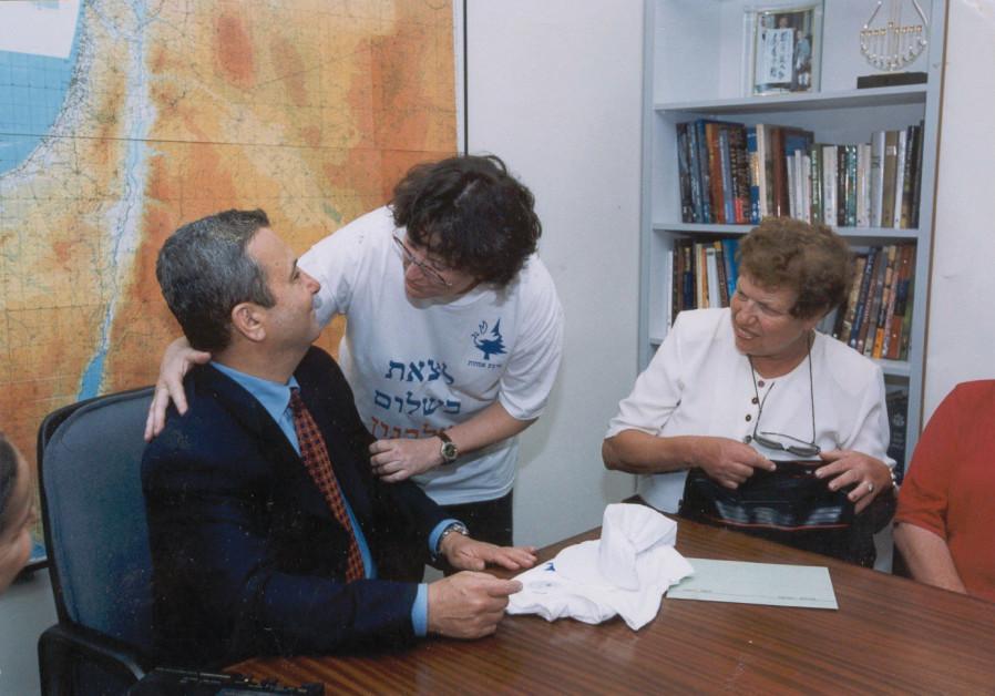 FOUR MOTHERS founder Dr. Rachel Ben Dor hugs prime minister Ehud Barak after the IDF withdrawal from Lebanon. (Dr. Rachel Ben Dor)