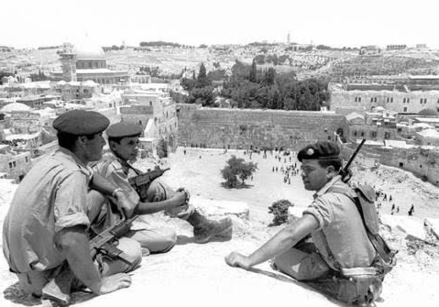 Israeli soldiers overlook the newly liberated Western Wall and the Old City of Jerusalem in June 1967 (Photo: Dan Hadani). From the Dan Hadani Archive, part of the Pritzker Family National Photography Collection at the National Library of Israel