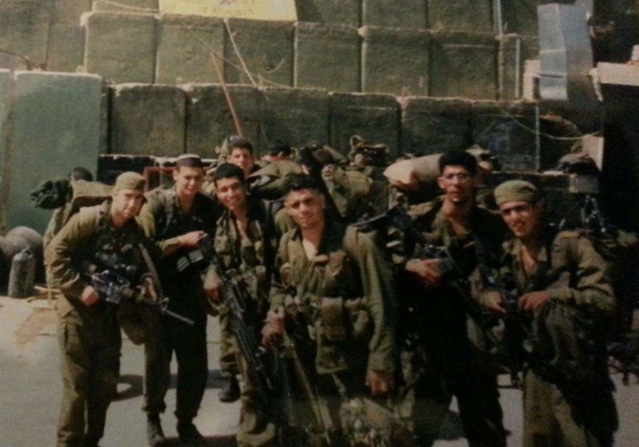 Lt.-Col. (res.) Shay Shemesh with members of his platoon during their time in Lebanon (Photo Credit: Shay Shemesh)