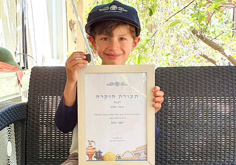 Imri Elia, who found the engraved clay plate, May 2020 (Credit: Israel Antiquities Authority)