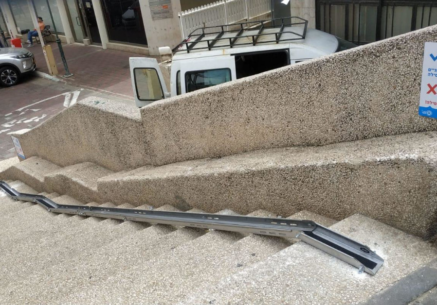 A ramp is seen by a public stairway in Tel Aviv to facilitate walking a bicycle up or down the stairs. (Photo credit: Courtesy of Tel Aviv-Yafo Municipality)