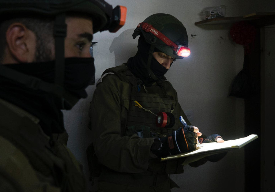 IDF soldiers map the house of Nizmi Abu Bakar, who is suspected of murdering First Sergeant Amit Ben Yigal, June 11, 2020 (Photo Credit: IDF Spokesperson's Unit)