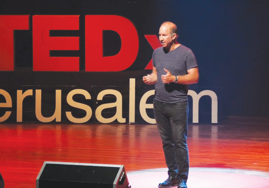 Elie Wurtman gives a TED talk (Credit: Courtesy)