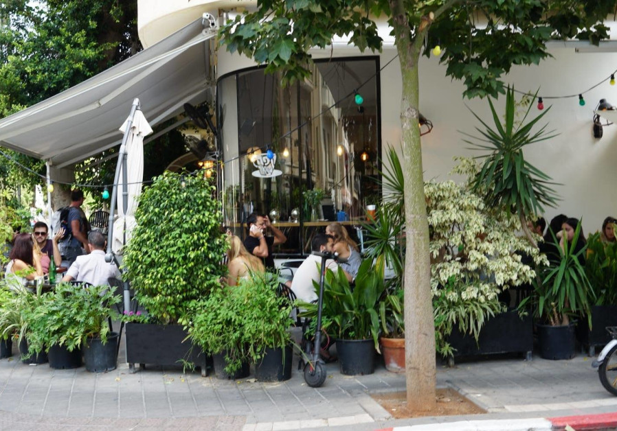SITUATED AT the intersection of Pinsker and Zalman Schneour streets in Tel Aviv, the cafe is described by its owner (at bottom) as 'a place where people, food and good atmosphere meet.' (Photo Credit: Antony Hatchuel)