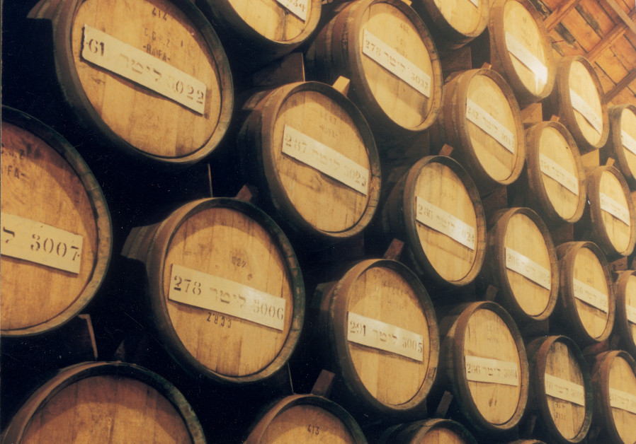 THE HISTORIC brandy cellar at Rishon Lezion Cellars, with casks from floor to ceiling. (Photo Credit: Courtesy Carmel)