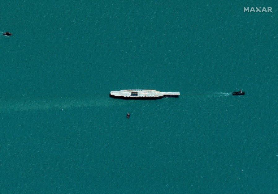 Iran's refurbished mockup aircraft carrier is seen towed by a tugboat near Bandar Abbas, Iran July 25, 2020 (Photo Credit: Maxar Technologies/via REUTERS)