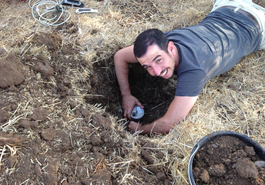 Guy Lang (University of Haifa) installs a seismometer in the ground. (Naama Sarid)