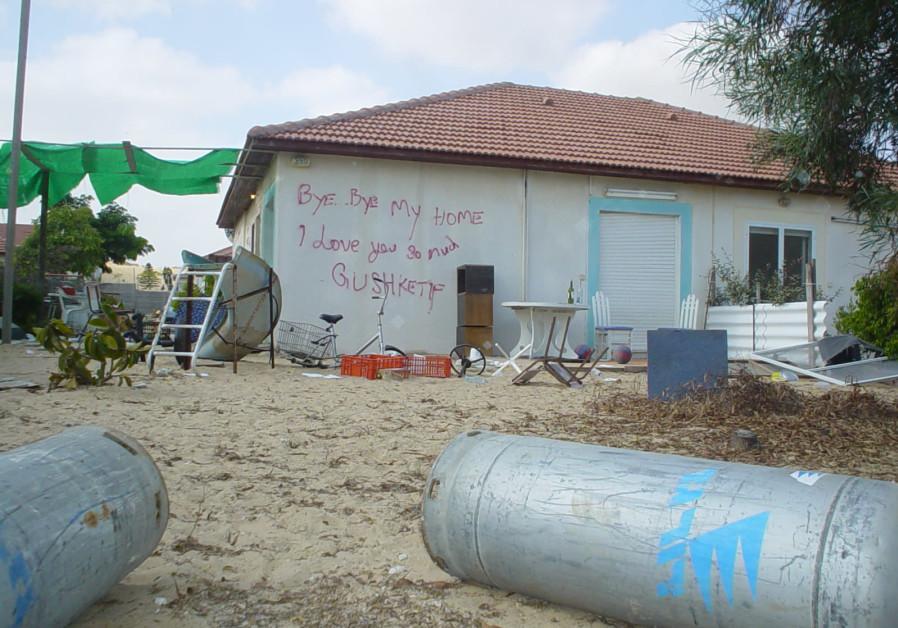 GRAFFITI ON a Neveh Dekalim home. It reads, 'Bye bye my home/I love you so much/Gush Ketif (sic),' August 17, 2005. (Credit: Arieh O'Sullivan)
