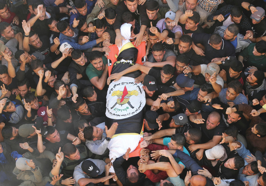 MOURNERS CARRY al-Ata's body during his funeral on November 12, 2019. The IDF killed just the target and his wife, with no injuries to their five children sleeping in the next room.  (Credit: Mohammed Salem/Reuters)