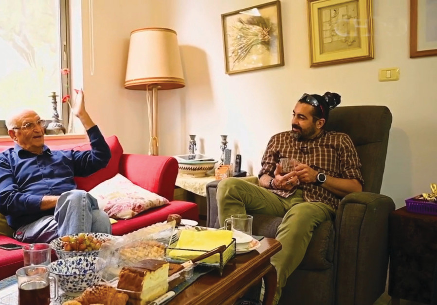 THE FILMMAKER sips tea and speaks with another Persian-Israeli about his life in Iran before immigrating to Kibbutz Alumim. (Credit: Courtesy of Human David Rawarpoor/Instagram/Manoto)