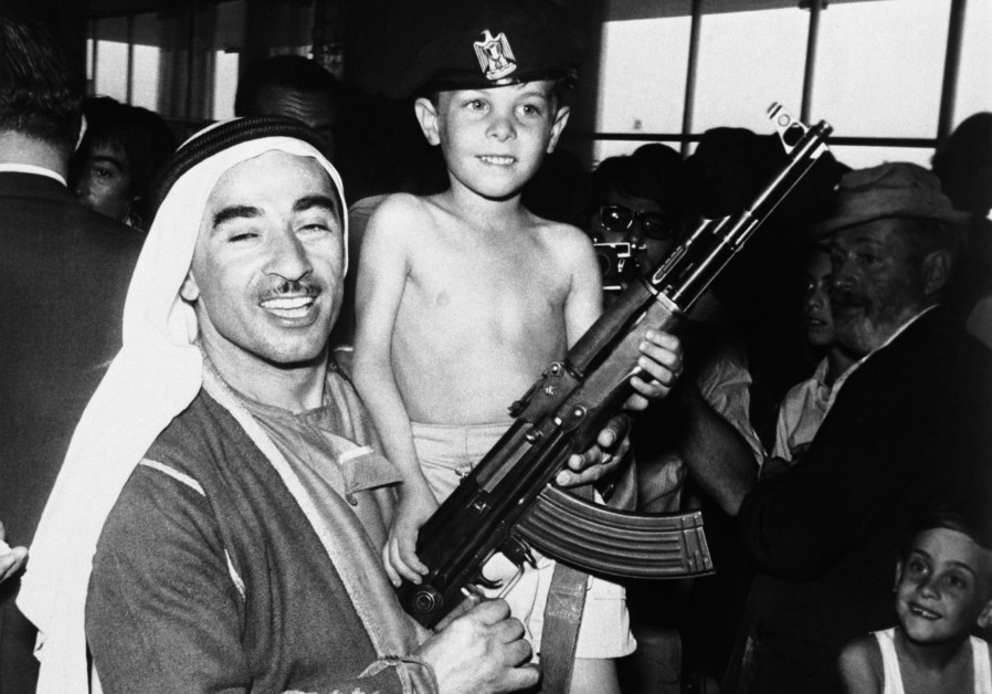 YARON RAAB, 6, with a Bedouin man at the Intercontinental Hotel in Amman after being released from the hijacked plane on September 12, 1970, with brother Noam, 8, looking on. (Bettmann/Corbis, Courtesy David Raab)