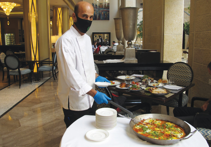 CHEF WALEED ASHAYER serves up shakshuka at the Waldorf-Astoria Hotel, Jerusalem. (Photos: Heddy Breuer Abramowitz)