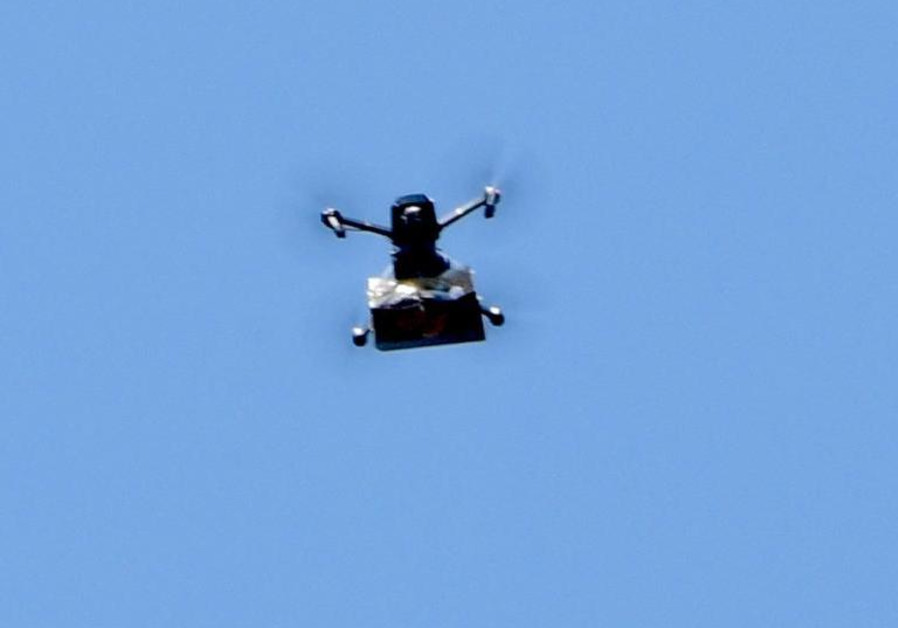 A drone drops hundreds of bags of cannabis in the skies of Tel Aviv. (Credit: AVSHALOM SASSONI)