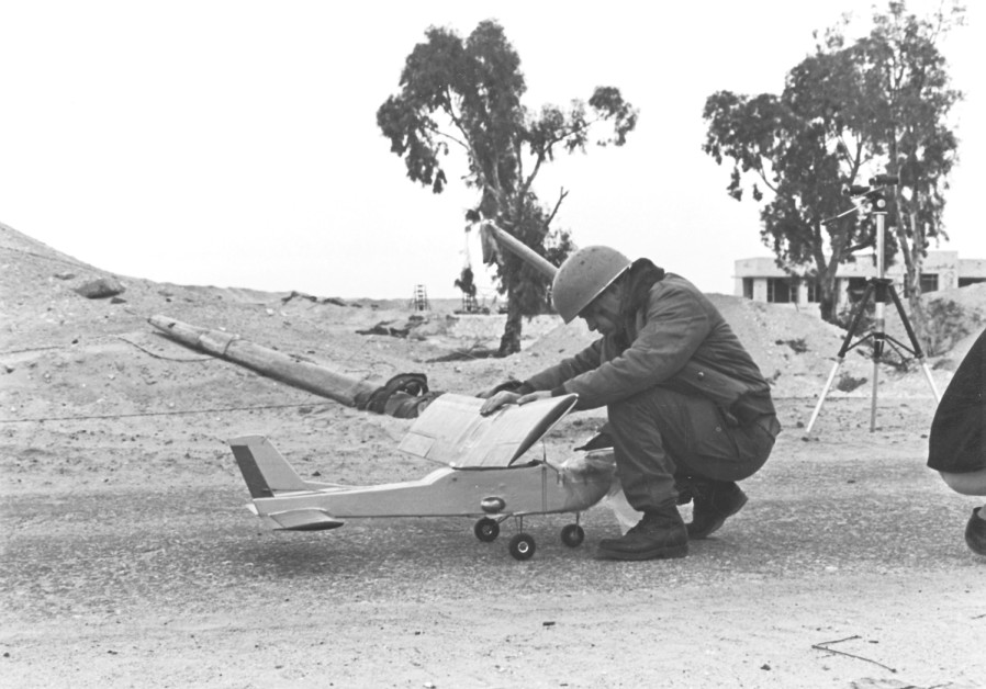 AN UNIDENTIFIED soldier assembles the toy airplane Israel flew over the Suez Canal in 1969. (Courtesy of Shabtai Brill)