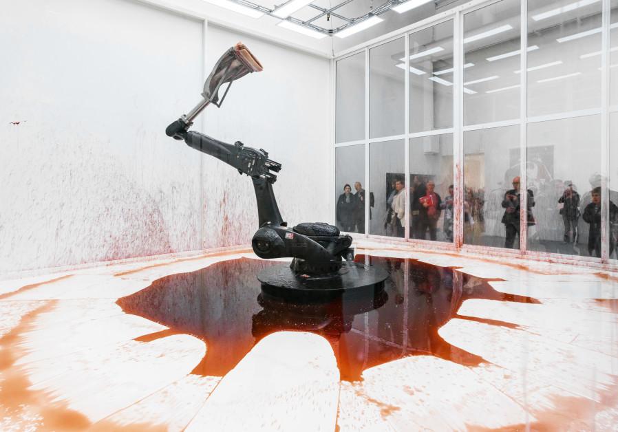 CHINESE ARTISTS Sun Yuan and Peng Yu convey the limitations of technological creaitons, and human voyeurism, in 'Can't Help Myself.' (Sun Yuan/Peng Yu)