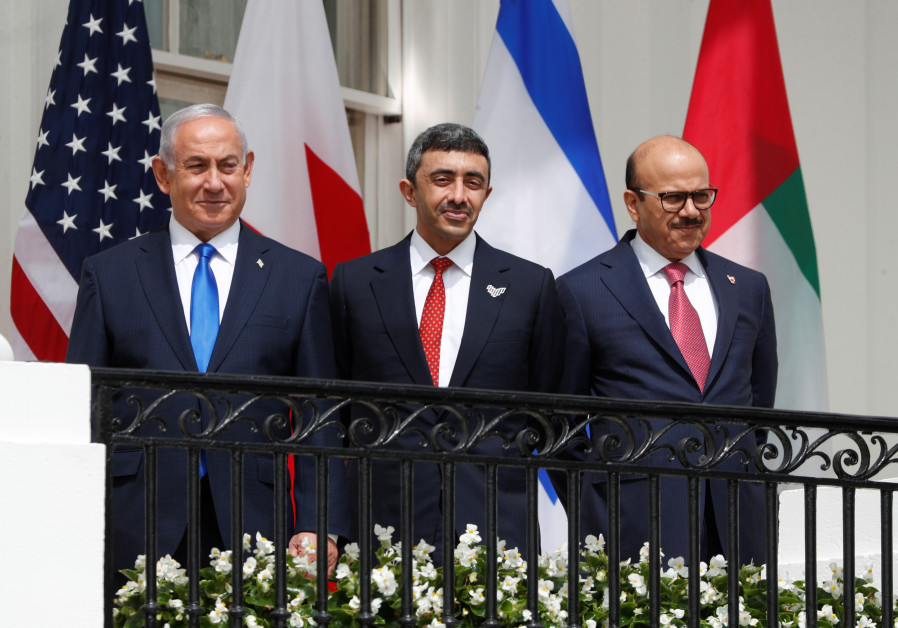 Israel's Prime Minister Benjamin Netanyahu, United Arab Emirates (UAE) Foreign Minister Abdullah bin Zayed and Bahrain's Foreign Minister Abdullatif Al Zayani standby prior to signing the Abraham Accords with US President Donald Trump at the White House in Washington, US, September 15, 2020. (Credit: Reuters/Tom Brenner)