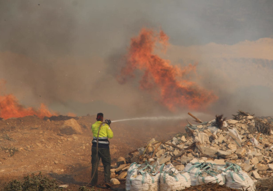 Fire services work to contain a wildfire in the area of Umm al-Fahm, October 10, 2020. (FIRE AND RESCUE SERVICE)