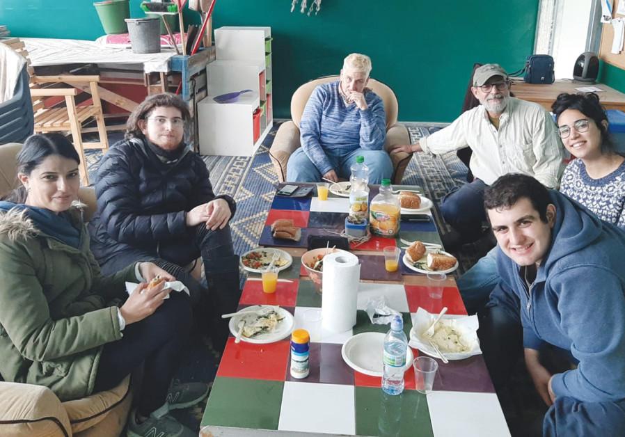 ENACHEM STOLPNER (third from right) and some of his crew. (Courtesy Menachem Stolpner/Kibbutz Shluchot)
