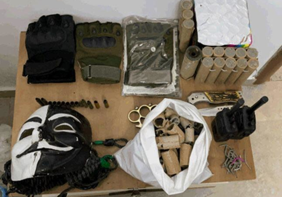 Weapons, ammunition, uniforms and money confiscated by the Shin Bet (Credit: Shin Bet)