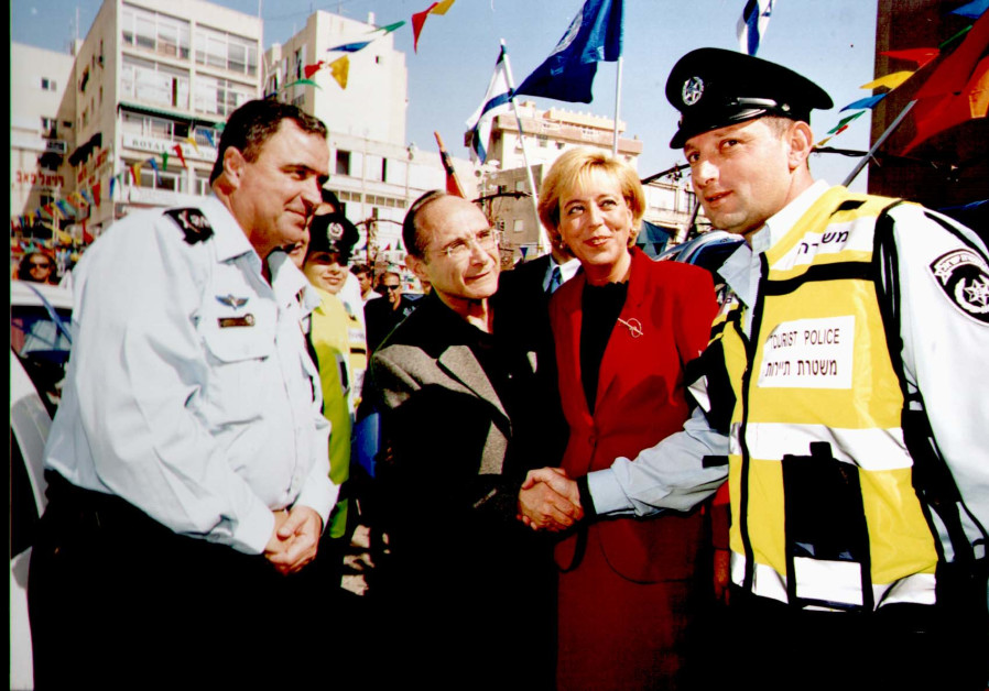 Detective Marc Kahlberg (right) is congratulated by (from left) Police Commissioner Shlomo Aharonishki, Internal Security Minister Uzi Landau and Netanya Mayor Miriam Feirberg after creating a successful secure zone at the end of 2002 to prevent further terrorist attacks in Netanya (Courtesy)