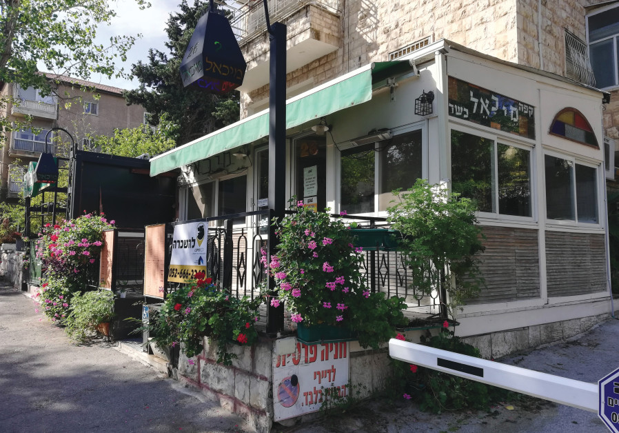 FOR RENT: Cafe Michael, a popular spot in Jerusalem's Katamon neighborhood that announced its closure in October: 'We were in a very good place before corona.' (Photo: Zev Stub)