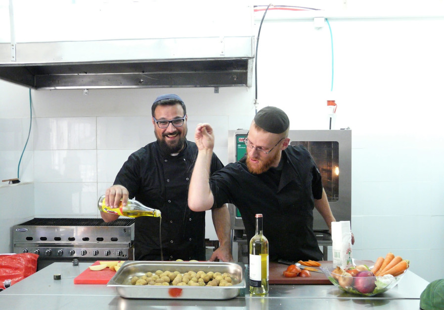 KINAMON CO-OWNERS Ben David (right) and Moshe Herc Holmer at work in the kitchen. (Courtesy Kinamon)
