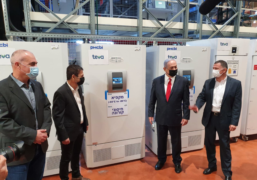 Prime Minister Benjamin Netanyahu and Health Minister Yuli Edelstein visit the Teva SLE Logistic Center, which is due to store and handle the vaccines against coronavirus under special conditions, November 26, 2020 (Credit: Courtesy)