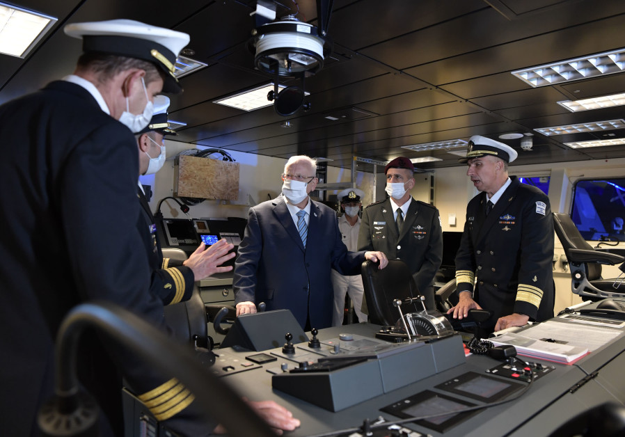 President Reuven Rivlin is seen inside the control room of Israel's new Sa'ar 6 warship on December 2, 2020. (Photo credit: Koby Gideon/GPO)