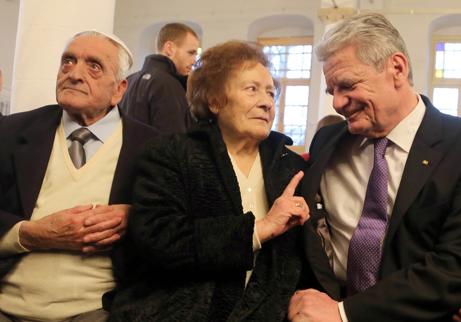 Esther Cohen is flanked by her husband Samuel, left, and German President Joachim Gauck in Ioannina, Greece, March 7, 2014. (Credit: Wolfgang Kumm/picture alliance via Getty Images)