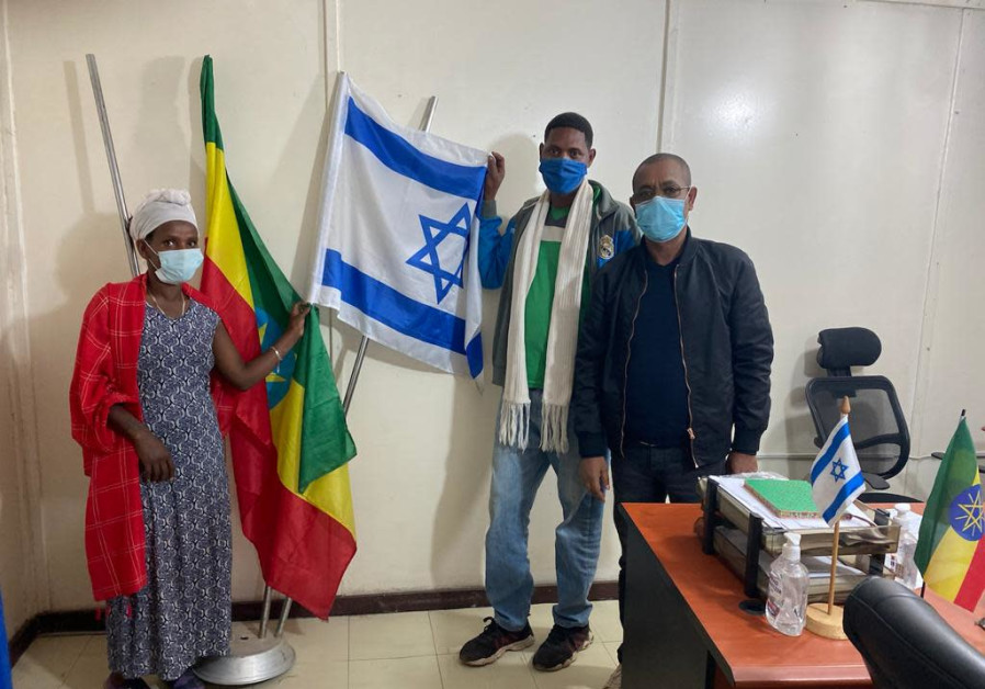 Jewish Agency shaliach to Ethiopia Adena Tadela in Gondar with a family that is making aliyah on Operation Zur Israel. (Jewish Agency)