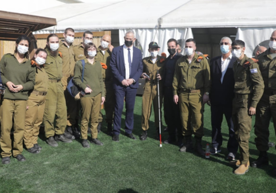 Welfare Minister Itzik Shmuli, and commander of the Home Front Command Maj.-Gen. Uri Gordin meet with people with disabilities who volunteer in the IDF, December 4, 2020. (Credit: Elad Malka)
