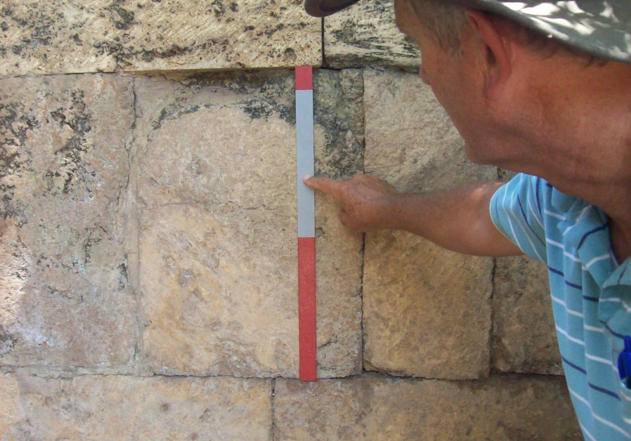 "Prof. Jeff Chadwick (BYU) measures a stone ashlar block in an ancient wall with a special 54 cm ""cubit"" stick [Photo credit: Jeff Chadwick]"