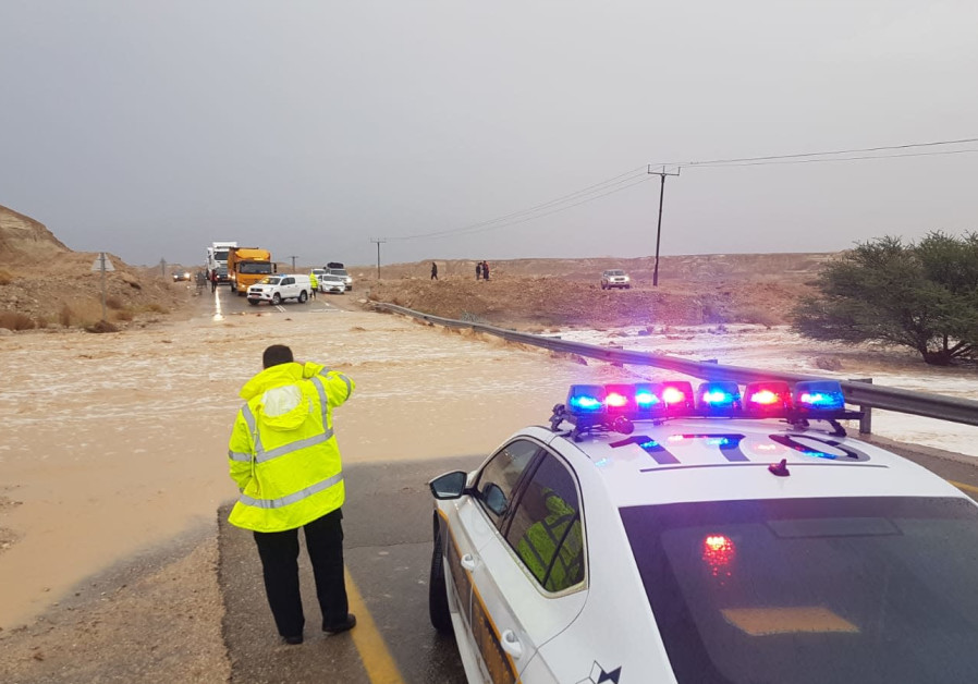 Traffic officers redirect traffic on Route 90 as sections of the road were flooded, Wednesday, December 16, 2020. (Credit: Police Spokesperson's Unit)
