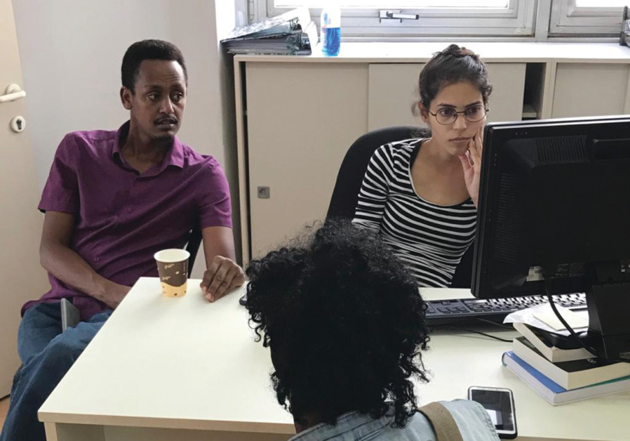 African migrant activist Ghere Meles (left, at the hotline) (COURTESY - HOTLINE FOR REFUGEES AND MIGRANTS)