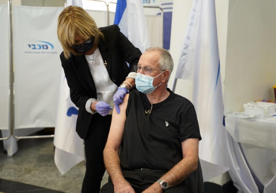 Maccabi Healthcare Services CEO Ran Saar receives the coronavirus vaccine (Credit: Courtesy Maccabi Healthcare Services)
