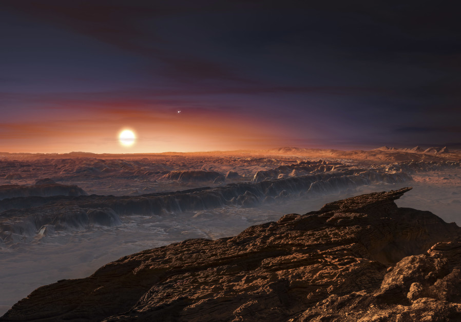 A view of the surface of the planet Proxima b orbiting the red dwarf star Proxima Centauri, the closest star to our Solar System, is seen in an undated artist's impression released by the European Southern Observatory August 24, 2016. (Photo credit: ESO/M. Kornmesser/Handout via Reuters)