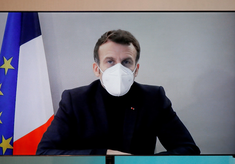 French President Macron, tested positive for coronavirus, talks by video conference in Paris (REUTERS).