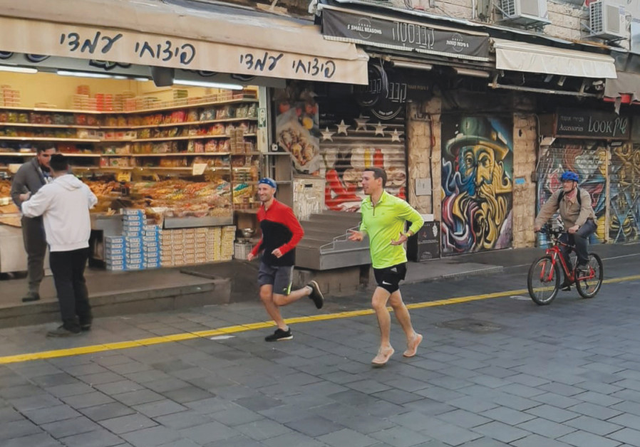 SNEAKERS TO the pavement at the Jerusalem shuk. (Photo credit: Running Around Jerusalem)
